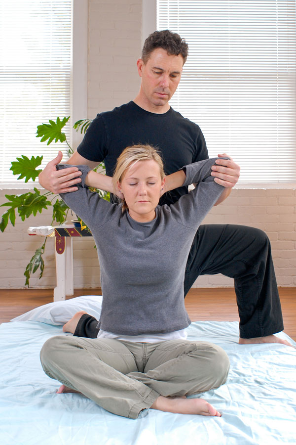 Gary Helping Woman Stretch Her Back